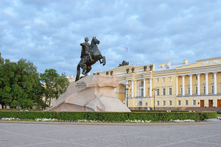 Monument to Peter 1, the bronze horseman in front of the building of Senate and Synod during the white nights in St. Petersburg on a background of clouds.