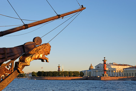 The bow of the ship and the view of the arrow of Vasilevsky island on a Sunny summer day in St. Petersburg. Stock Photo