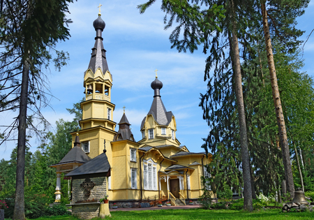 The Church of the Holy apostles Peter and Paul in the village of Vyritsa in the Leningrad region in the summer on a Sunny day.. Stock Photo
