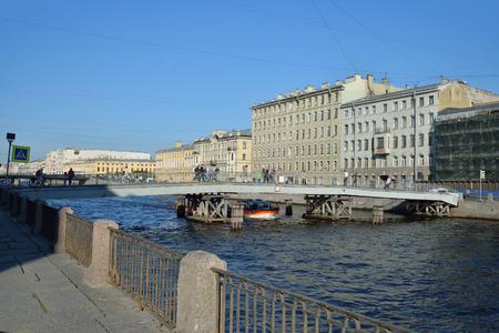 River boat Gorkinym under the bridge on the river Fontanka  in Saint-Petersburg