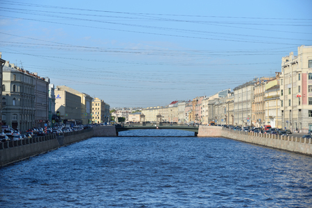 grille: Views of Leshtukov bridge across the river Fontanka and river boat on the water  in Saint-Petersburg
