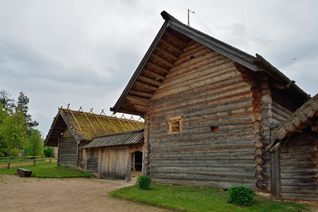 Old Russian log hut in Pushkin Mikhailovskoe summer cloudy day