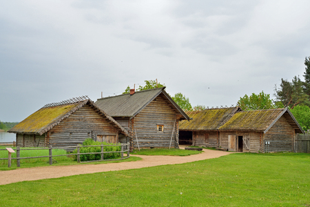 Old Russian log hut in Pushkin Mikhailovskoe summer cloudy day