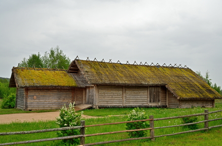 Old wooden log barn in the Museum of Pushkin Mikhailovskoe village summer cloudy day Stock Photo