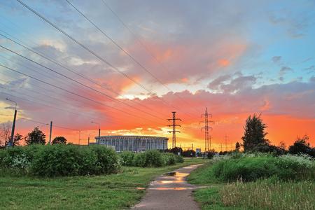 lenin: CCM St. Petersburg , the former V. I. Lenin and high-voltage power line at sunset after rain