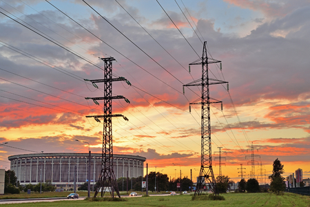 St.PETERSBURG, RUSSIA - 2017 JUNE 18, Sports and Concert complex St. Petersburg and supports high voltage power lines at sunset