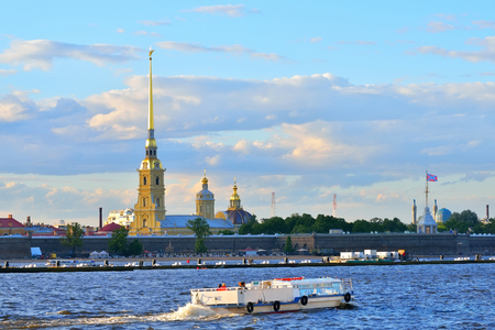 Pleasure boat floats on the Neva river on the background of the fortress in Saint-Petersburg. Stock Photo