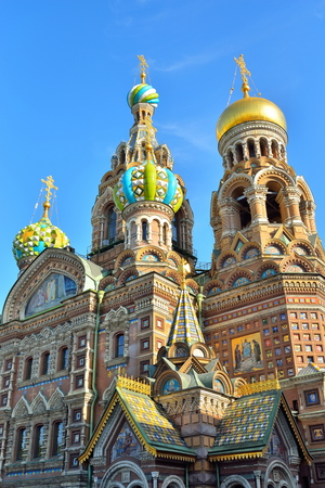 Church of the Savior on spilled Blood illuminated by the sun against the blue sky Stock Photo