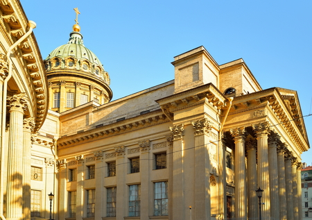 The dome and colonnade of the Kazan Cathedral in sunlight against the sky