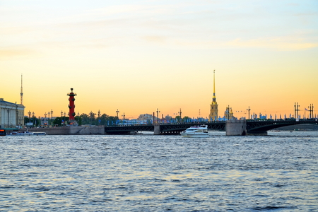 Sunset on the Neva river on the background of the Peter and Paul fortress and Rostral columns