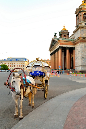 Horse-drawn carriage on the background of St. Isaacs Cathedral