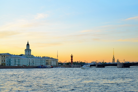 Sunset on the Neva river on the background of the Kunstkamera, the Peter and Paul fortress and Rostral columns