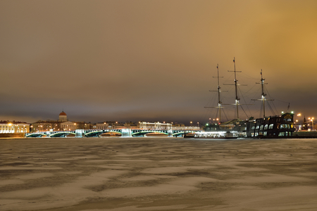 The view of the Exchange bridge and a Floating restaurant the flying Dutchman on the Fontanka embankment winter night in Saint Petersburg