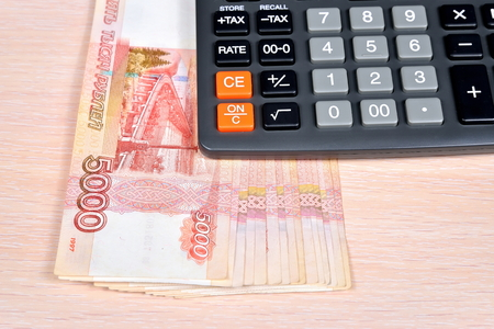 Russian money and calculator on the table. Business still life