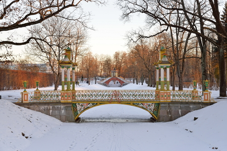 Painted the bridge with turrets through the Bypass channel in the Alexander Park in winter. Pushkin, Tsarskoye Selo, Saint Petersburg