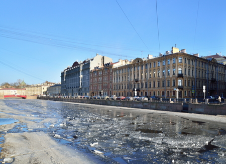 The promenade and the ice on the surface of the water on the river Fontanka in the spring
