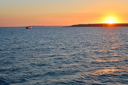 The view of the sunset over the Crimea with a ferry. Russia