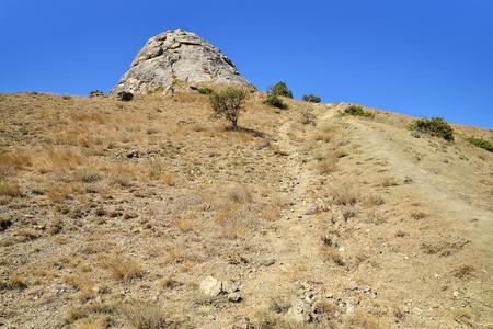 Mountain trail on a rocky slope. Crimea 스톡 콘텐츠