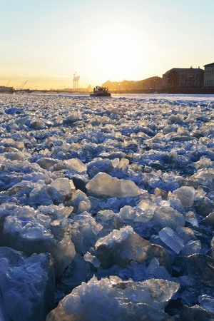 Ice blocks and MOE boat at sunset in Saint-Petersburg