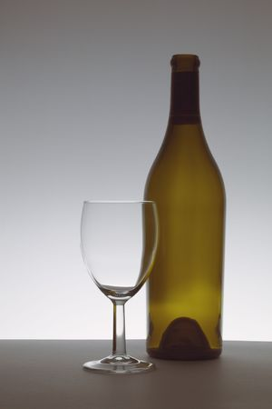 Wine glass and brown bottle