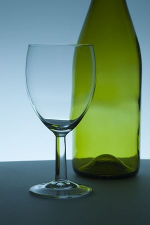 Wine glass and green bottle Stock Photo