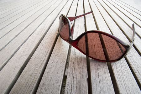 Sunglasses on wooden table