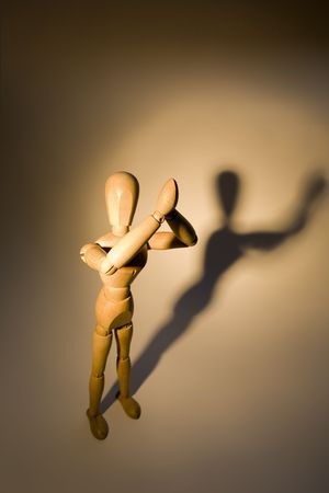 A wooden mannequin invoking higher powers