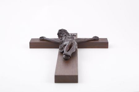 Crucifix shot from bellow with shallow DOF. isolated against white.