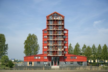 Modern architecture in Almere, Netherlands. Red condominion American style.  Stock Photo