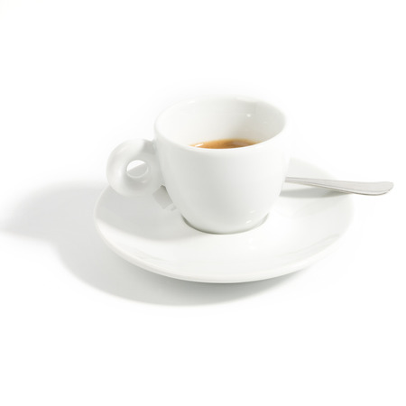 Single isolated espresso cup with dish and spoon Stock Photo