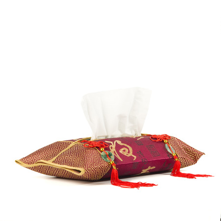 Oriental rich decorated tissue dispenser isolated on white.  Stock Photo