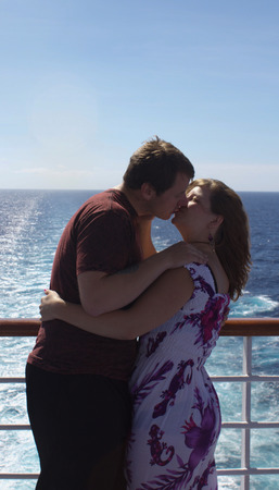 fantail: Honeymooners share a kiss on the fantail of their cruise ship Stock Photo