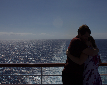 honeymooners: Silhouetted honeymooners  enjoy quiet moment at fantail of their cruise ship Stock Photo