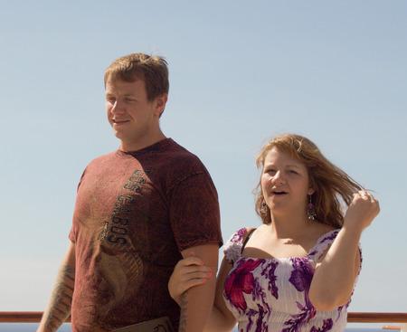 honeymooners: Honeymooners stroll the deck of their cruise ship in the bright sunlight