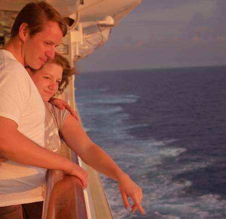 honeymooners: Honeymooners enjoy sunset contemplating the power of the sea Stock Photo