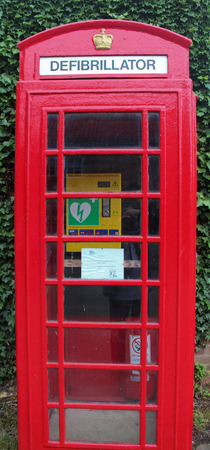 life saving: Converted UK Phone Box to a Life Saving Defribillator Station Stock Photo