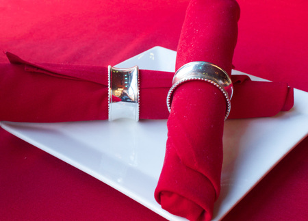 napkin ring: Red Napkins on a White Plate Stock Photo