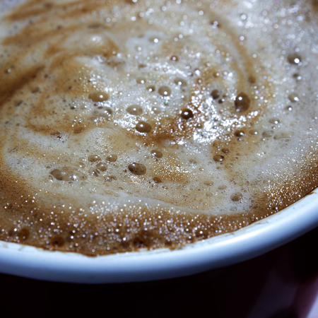 foam of espresso on a cup taken from close up