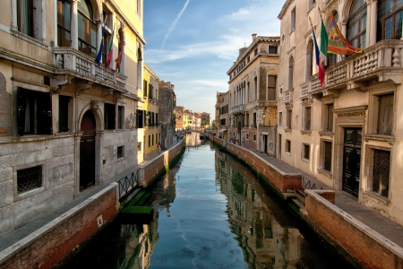 small and narrow canals of Venice photo