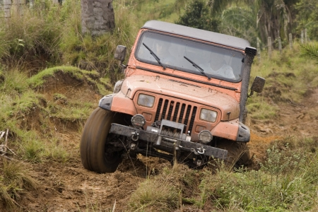 caked: Dirty jeep on competition Stock Photo