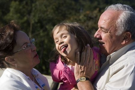 Grandparents and granddaughter enjoy together Stock Photo - 3535054