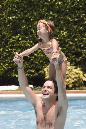 Father playing with his daughter in swimming pool Stock Photo - 5307820