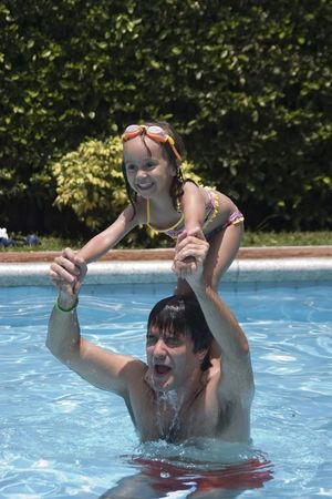Father playing with his daughter in swimming pool Stock Photo - 5307818