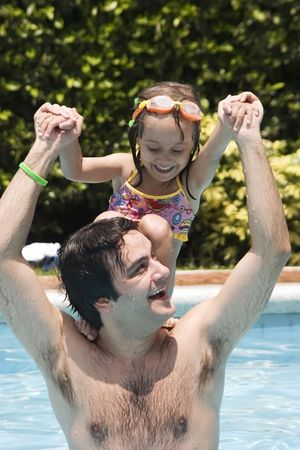 Father playing with his daughter in swimming pool Stock Photo - 5307816