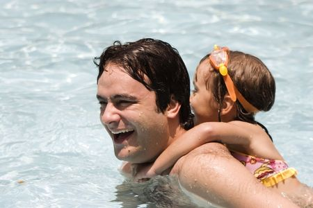 Father and daughter in Swimming pool photo