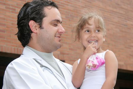 Little beautiful girl playing with her doctor Stock Photo - 5307833