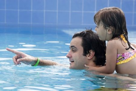 Father playing with his daughter in swimming pool Stock Photo - 4261280