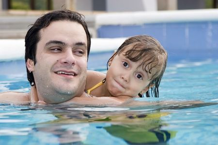 Father playing with his daughter in swimming pool Stock Photo - 4261295