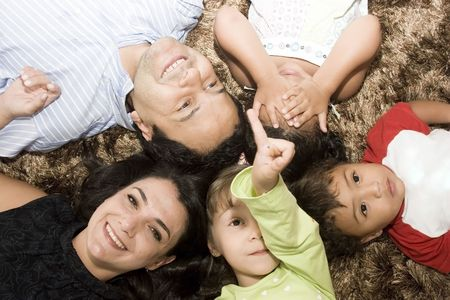 Portrait of Family, mom and dad playing with their children Stock Photo - 4261233
