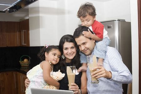 icebox: Portrait of beautiful family cooking in kitchen, dad, mom and little daughter Stock Photo
